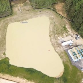 overhead of pond with open top tanks