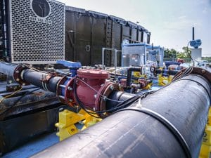Pumping system and tank